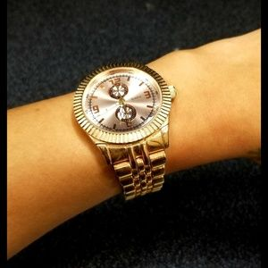 Rose gold face watch